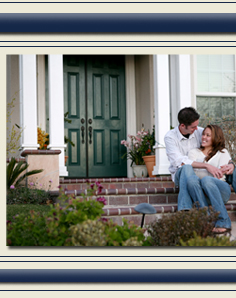 Couple in front of house