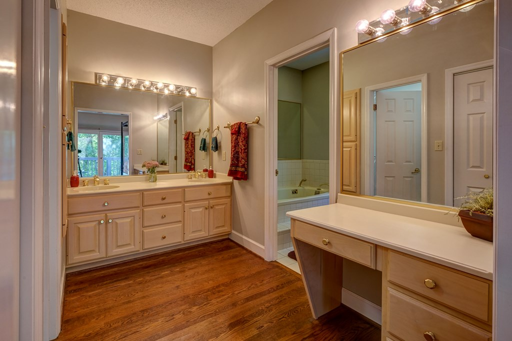 large master bath with shower and jetted tub