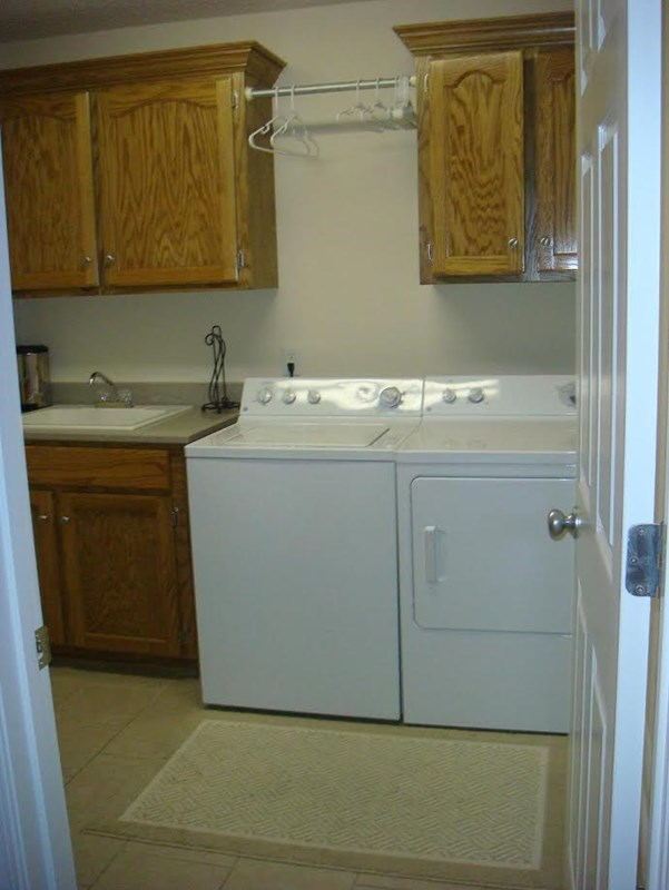 Huge laundry room with sink-ceramic tile floor