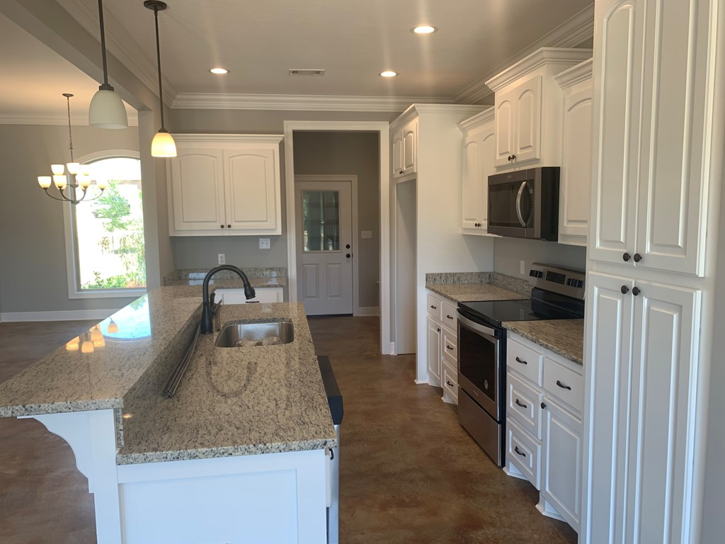 Granite counters in kitchen.