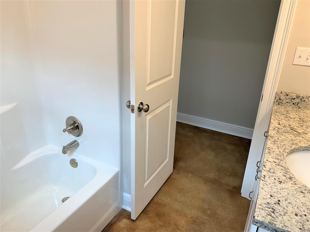 Tub/shower combination in second bath.