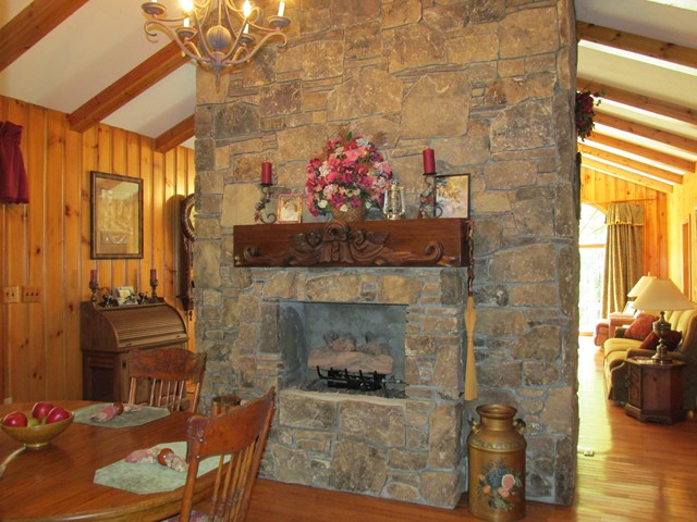Fireplace in breakfast table area