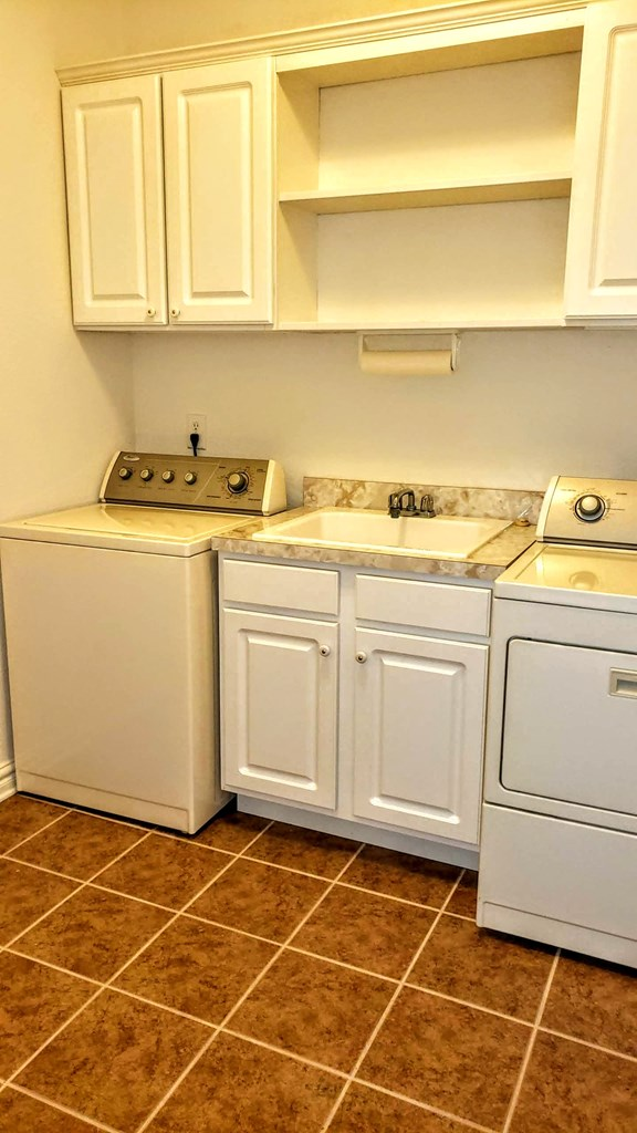Spacious laundry room with soaking sink