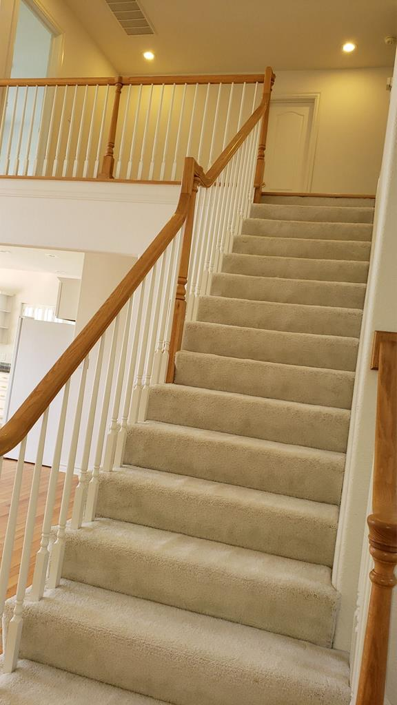 Grand staircase to upper loft